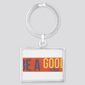 be a good human Keychains