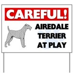 Careful Airedale Terrier At Play Yard Sign