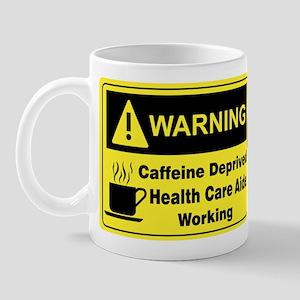 """Caffeine Warning H.C.A."" On Front of Mug"