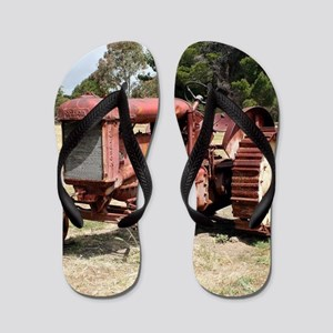 Old rusty tractor in the country Flip Flops