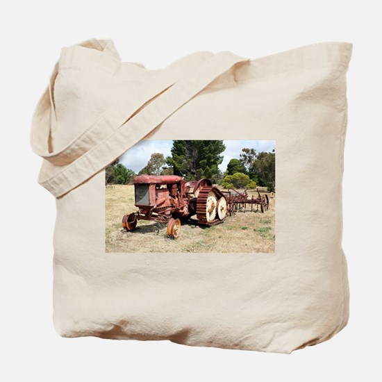 Old rusty tractor in the country Tote Bag