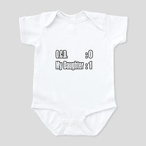 """Daughter Battles O.C.D."" Infant Bodysuit"