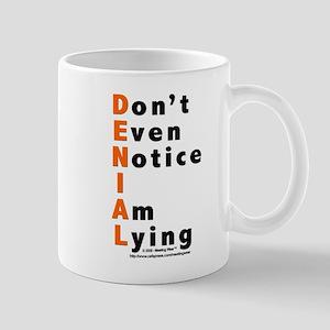 DENIAL Mug