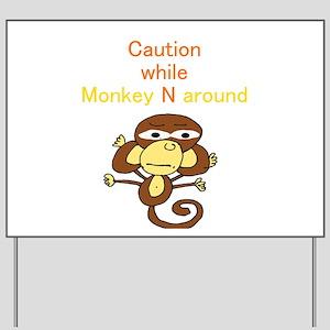 """Caution while Monkey N Aroun Yard Sign"