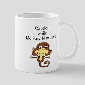 """Caution while Monkey N Aroun Mug"