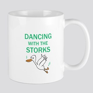 Dancing with the Storks Mugs