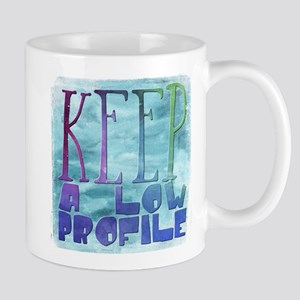 keep a keep a low profile Mugs