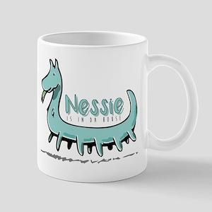 Nessie is in da house Mugs