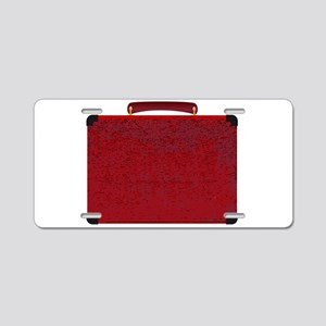 Red Small Suitcase On A Whi Aluminum License Plate