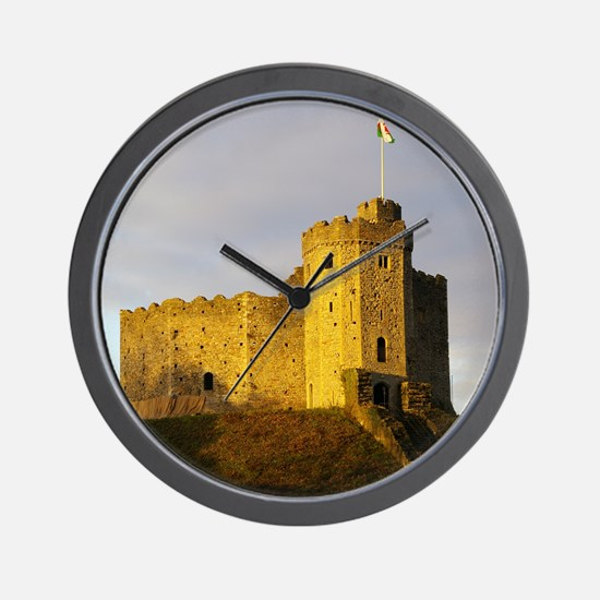 Castle at sunset Wall Clock