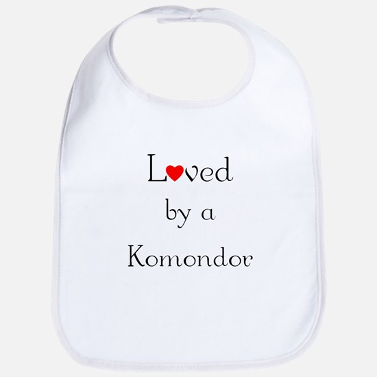 Loved by a Komondor Bib