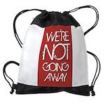 We're not going away Drawstring Bag