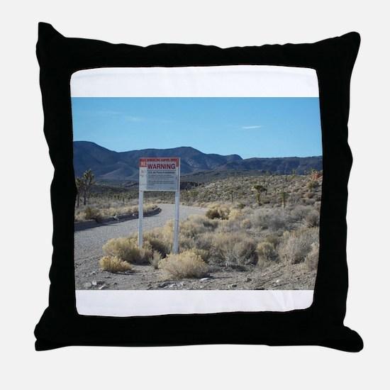 Warning Sign on Groom Lake Ro Throw Pillow