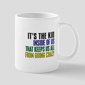 The Kid Inside Us Mug