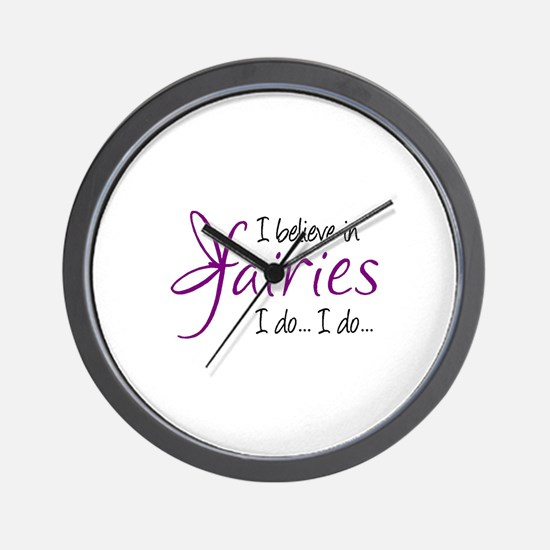 i believe in fairies color Wall Clock