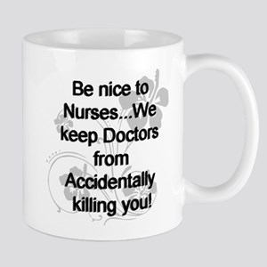 2-be nice to nurses copy Mugs