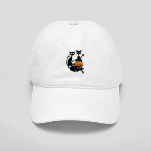 Three Black Kitties and a Pum Cap