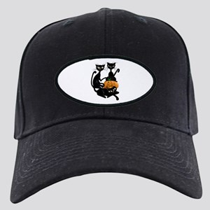 Three Black Kitties and a Pum Black Cap