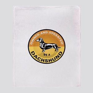 Owned and Operated by a Dachs Throw Blanket