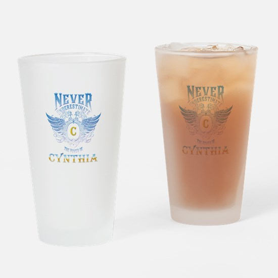 Never underestimate the power of cy Drinking Glass