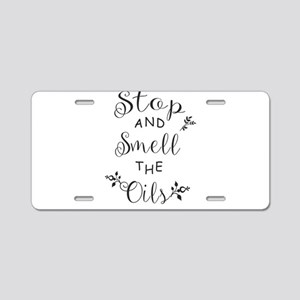 Stop and Smell the Oils Aluminum License Plate