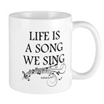 Life is a song we sing-tomaca Mugs