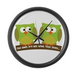The owls are not what they seem Large Wall Clock