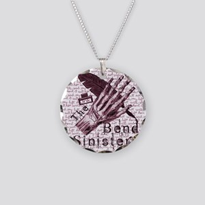Bend Sinister Necklace Circle Charm