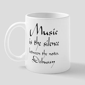 Debussy Silence Quote Mug