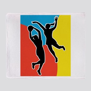 netball player jumping Throw Blanket