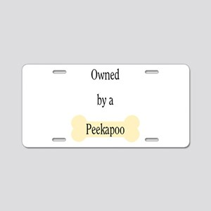 Owned by a Peekapoo Aluminum License Plate
