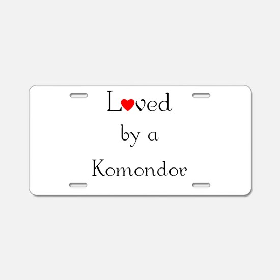 Loved by a Komondor Aluminum License Plate