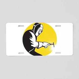 welder welding Aluminum License Plate