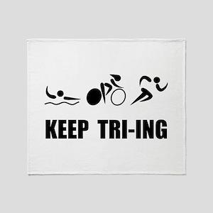 KEEP TRI-ING Throw Blanket