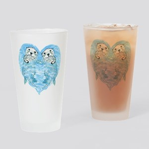 sea otters holding hands Drinking Glass