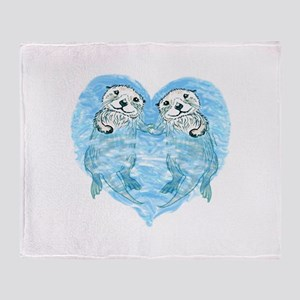 sea otters holding hands Throw Blanket