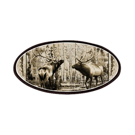 Bull elk face off Patches