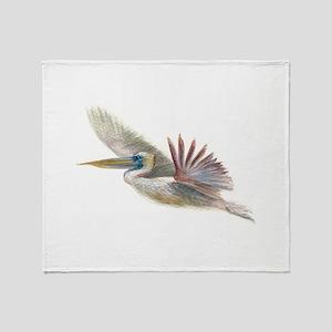 pelican in flight Throw Blanket