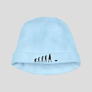 Evolution walking the dog baby hat
