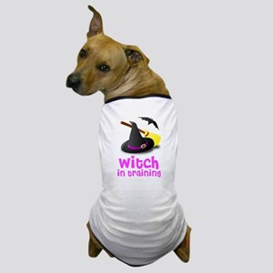 Witch in training hat broom b Dog T-Shirt