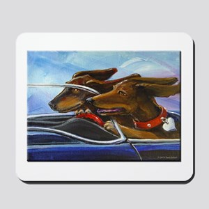 2 Dogs on a Roll Mousepad