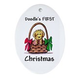 Puppies first christmas Oval Ornaments
