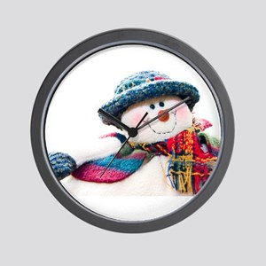 Cute winter snowman with blue hat Wall Clock