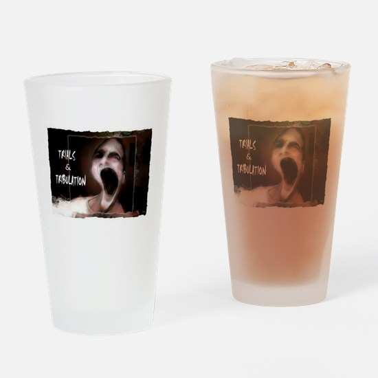 trials and tribulations Drinking Glass