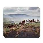Galloping herd in the dust Mousepad