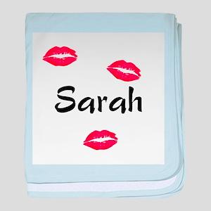 Sarah kisses baby blanket