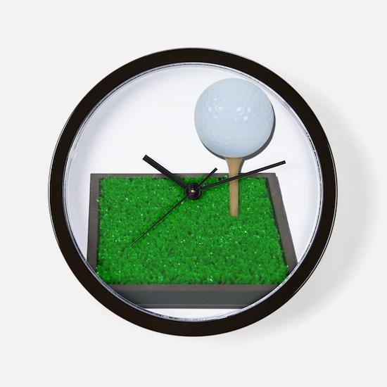 Golf Ball on Tee on Grass Wall Clock