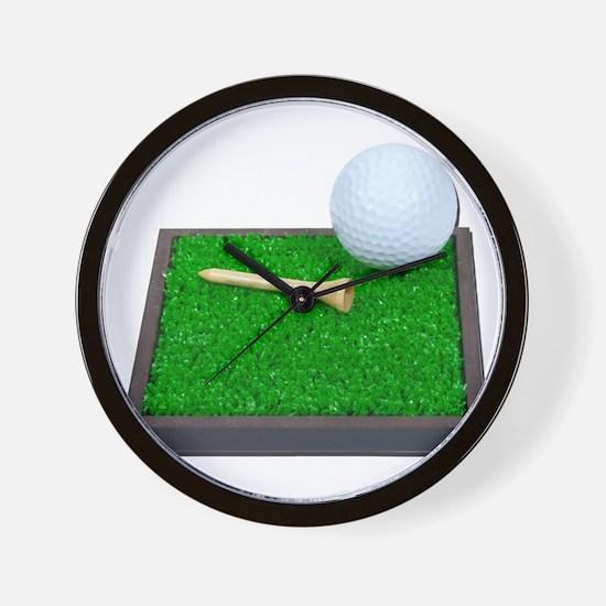 Golf Ball Tee Laying on Grass Wall Clock