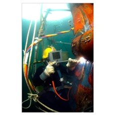 US Navy Diver welds a repair patch on the submerge Poster