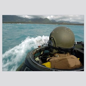 US Marine driving an amphibious assault vehicle th